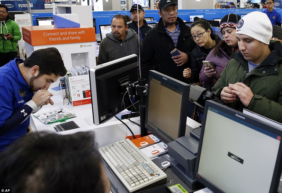 Customers are shown here waiting in line to purchase their electronics during the Black Friday rush on Friday at Best Buy in Skokie, Illinois