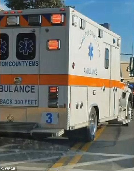 An ambulance rushed at least one person to hospital (pictured)