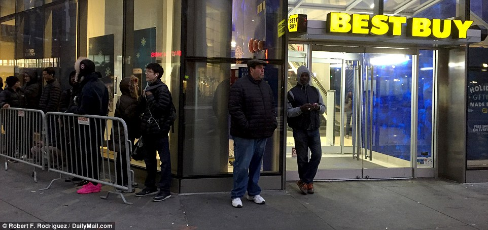 A group of hearty shoppers wait in line for doorbuster specials at 6.30am on Friday at Best Buy in New York's Union Square