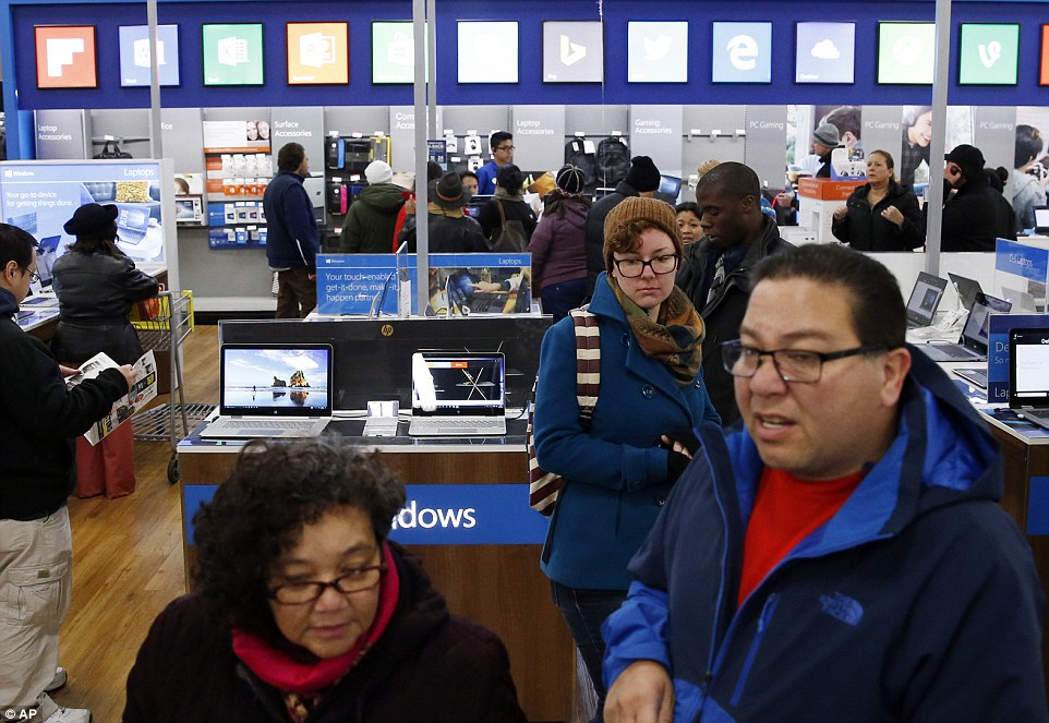 Black Friday shoppers are seen perusing the store for door-buster deals at Best Buy in Skokie, Illinois on Friday
