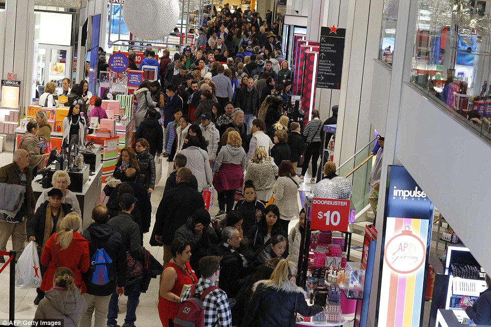 People shop at Macy's department store during the Black Friday sales on Friday in New York
