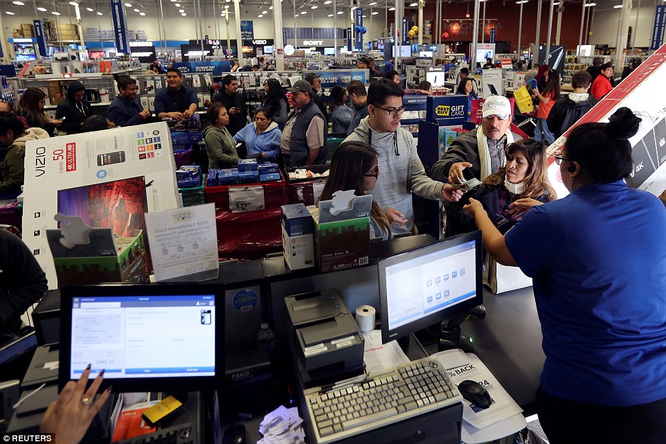 Shoppers pay for their purchases during Black Friday sales at a Best Buy store in Los Angeles, California on Friday