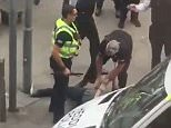 This is the moment police bundled a 'machete-wielding' man to the ground as two were arrested outside Cardiff stadium