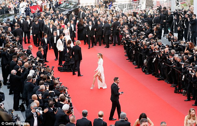 Petra-fied! The sizzling blonde flaunted her endless legs as she paraded through the sea of cameras