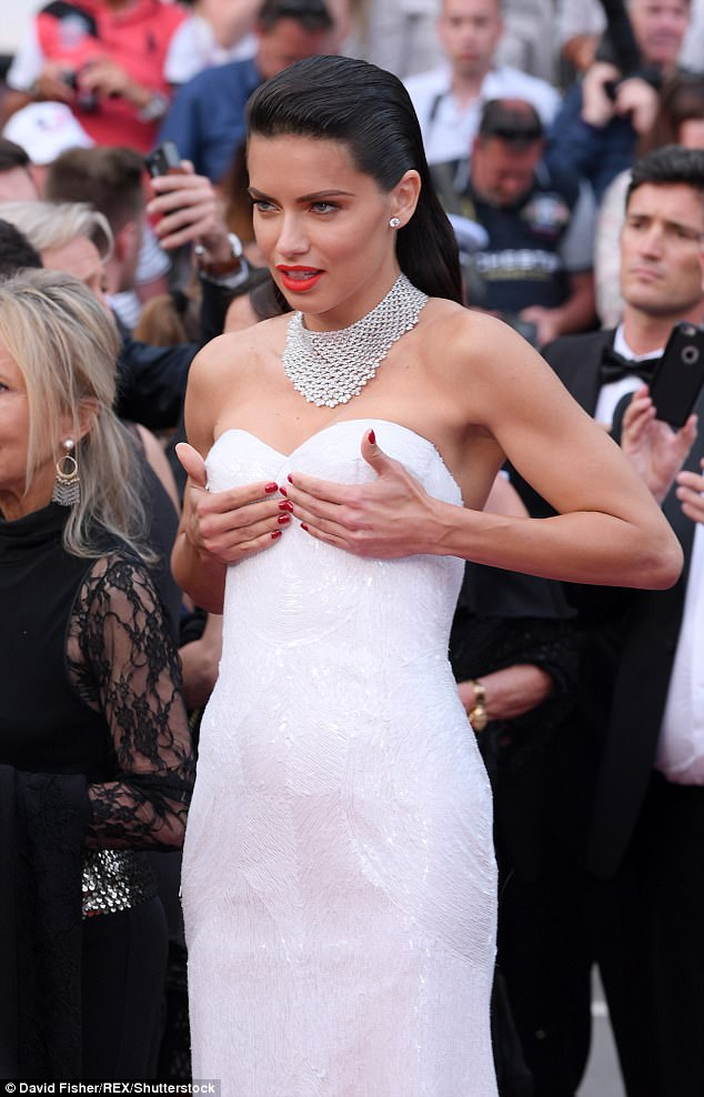 Hands on! Adriana held on to her ample cleavage while storming the red carpet