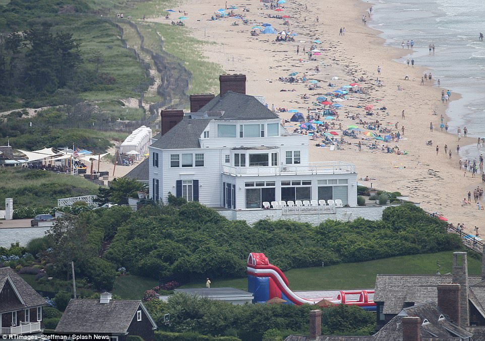 Cozy cottage on the beach: The home was still under extremely tight security however throughout the weekend, and the pop star's parents Andrea and Scott were seen in town