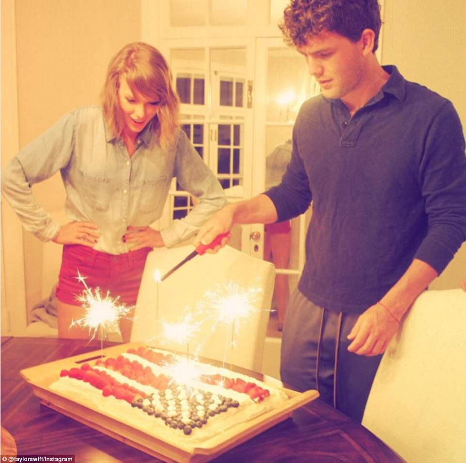 Younger brothers trends: Swift and her baby bro Austin display Ina Garten's famed red, white and blue cake (above)