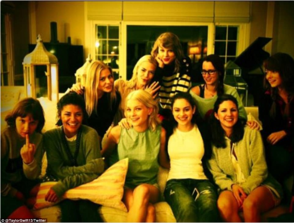 Indie production: An uncertain Emma Stone perches on the far right of the frame looking at Swift's inaugural squad of: Amanda Griffith, King, Swift and Ingrid Michelsen (back row l to r): Lena Dunham, Jessica Szohr, Jessica Stam, Odeya Rush and friend (front row l to r)