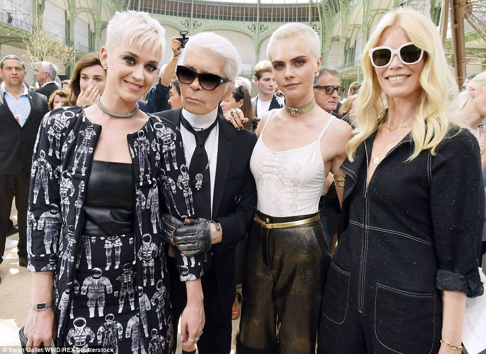 Squad 2.0: Delevingne returned to her fashion roots as well on Monday at the Chanel show with Katy Perry, Karl Lagerfeld,  and Claudia Schiffer