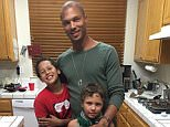 'Hot felon' Jeremy Meeks shared a photo on July 4 showing him posing alongside his two sons (above). It's unclear when the photo was taken, but he shared minutes after his wife shared an image to her account posing with her sister. She broke her silence about the photos showing him cheating on her with a 26-year-old British heiress