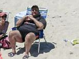 'So he's the only one on the beach, and then he allows himself to be photographed in a lounge chair with his grin on his face,' O'Reilly said on Glenn Beck's radio show Friday morning