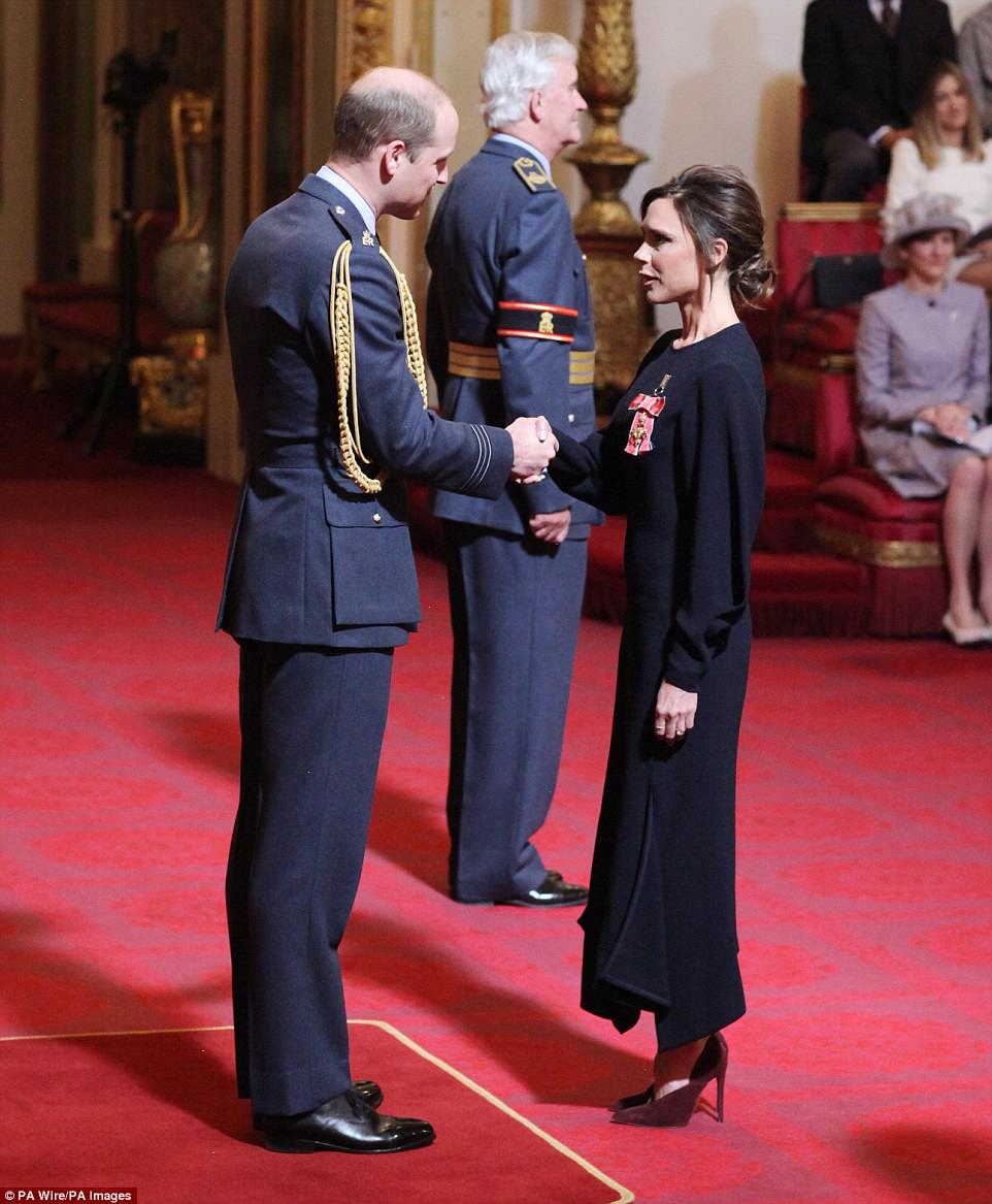 Loving life: It's not the first time the Beckhams have been at the palace. Victoria received an OBE for her contribution to fashion from the Duke of Cambridge back in April