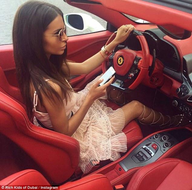 Russian blogger Yulianna YS poses inside a Ferrari as she enjoys a drive around the city