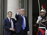 French President Emmanuel Macron, left, welcomes a waving U.S President Donald Trump before their meeting at the Elysee Palace in Paris, Thursday, July 13, 2017. Trump will be the parade's guest of honor to commemorate the 100th anniversary of the U.S. entry into World War I. U.S. troops will open the parade Friday as is traditional for the guest of honor. (AP Photo/Markus Schreiber)