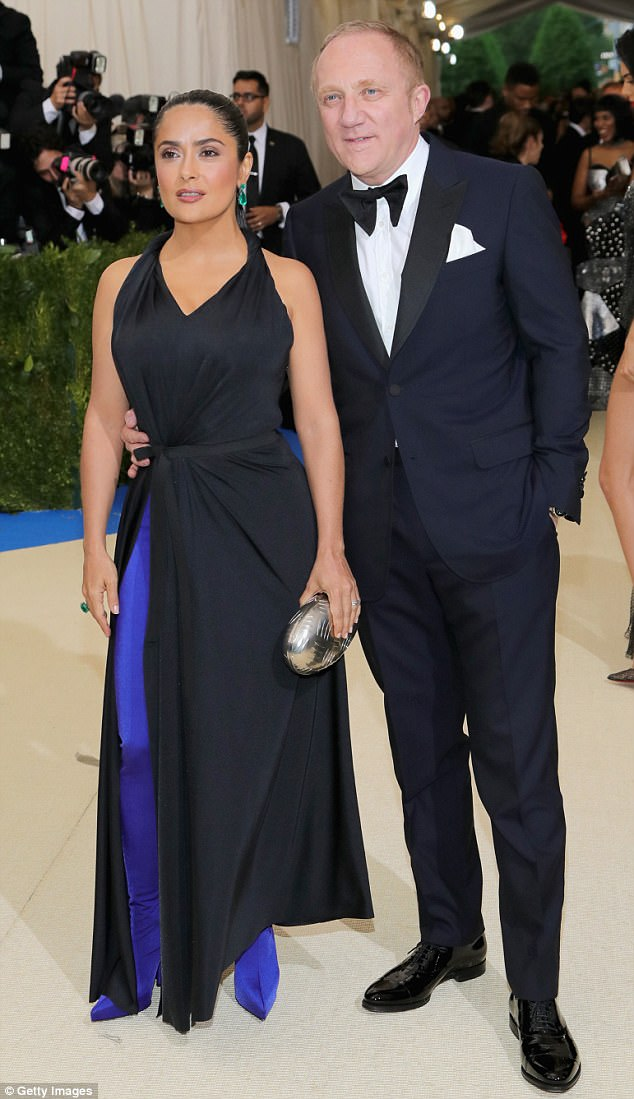 Cameraman:'Beside #SelenaGomez and #TheWeeknd can you guess who are the other dancers in this video I took at the #metball?' wrote Hayek on the post (above with husbandFrancois-Henri Pinault at the Met Ball)