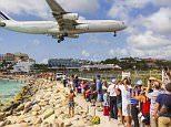 A woman has been killed after she fell and hit her head when the force of a jet flying overhead blew her from her feet at a world famous beach (pictured) in Saint Maarten, the Caribbean