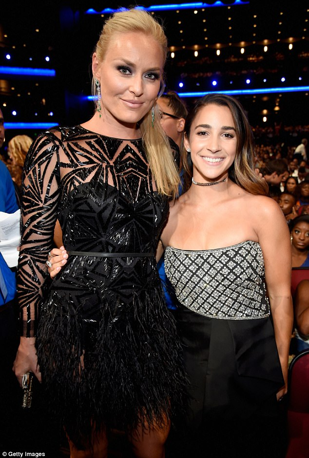 Black magic: The Olympic skiing gold medalist, 32, looked stunning in a  black Monique Lhuillier dress as she posed with Olympic gold gymnast Aly Raisman, 23