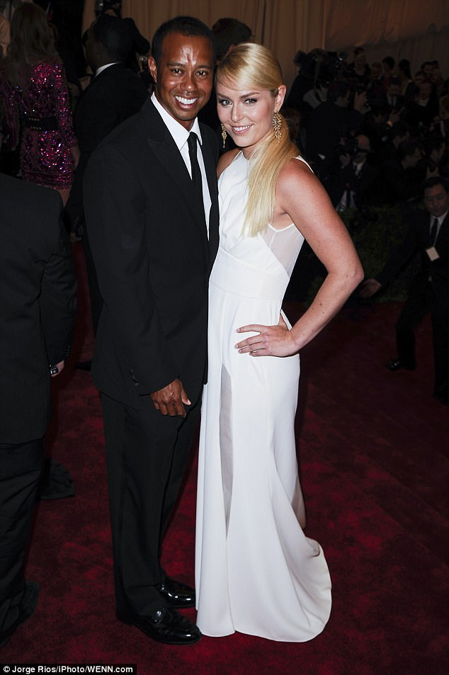 Still concerned about him: Lindsey, seen with Tiger in 2013, split with the golfer in 2015 after three years. She said they are still friends, adding, 'I reached out and I hope he's doing well'
