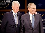 Former President Bill Clinton (left) and former President George W. Bush (right) participate in a moderated conversation at the graduation class of the Presidential Leadership Scholars program at the George W. Bush Presidential Library in Dallas, Texas on Thursday