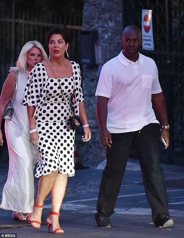 Glamorous: Kris stunned in a white polka dot dress which clung to her figure, set off with a matching caped jacket