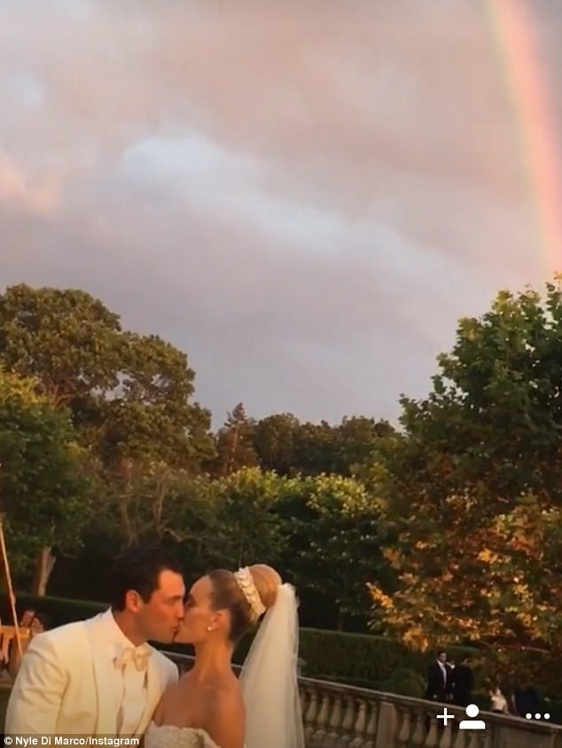 Sealed with a kiss: The gorgeous couple smooched amid the idyllic setting on their special day