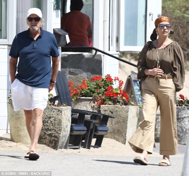 Weekend wear: While the Welsh born actress went for classic glamour in breezy brown, Michael was low-key in white shorts, a dark polo and flip flops