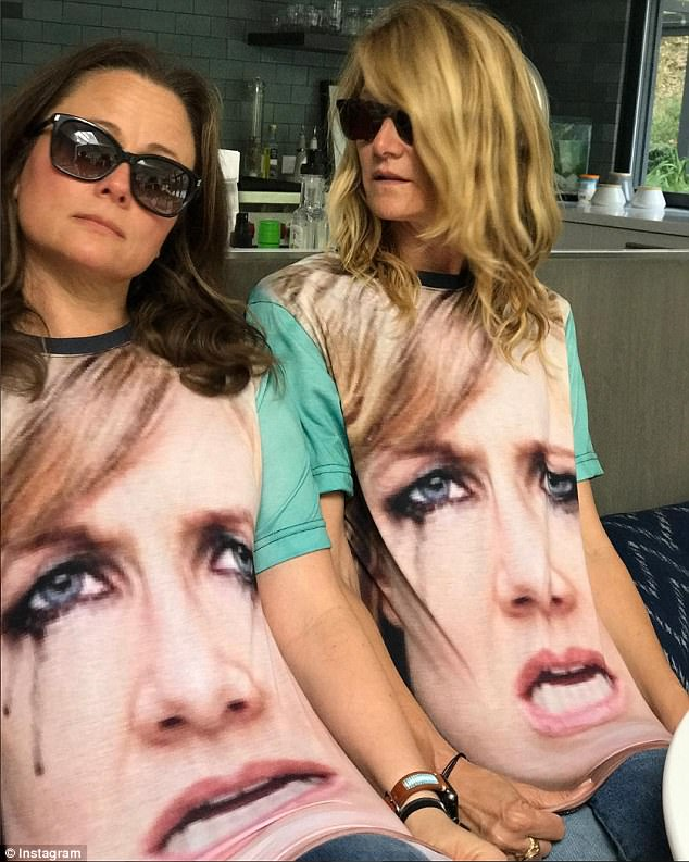 With open arms: By Friday, Laura was clearly enjoying her meme-dom, donning a T-shirt with her own crying face on it