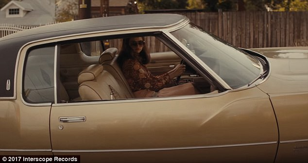 So seventies: The Texas native is spotted here in a vintage car