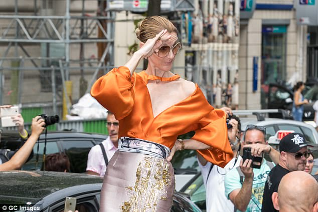 Loud and proud: Celine Dion showed off her impeccable style credentials as she emerged from her Parisian hotel in an asymmetric blouse and a metallic skirt