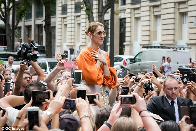 Polished: Celine added a retro feel to her look with a pair of circular tinted sunglasses