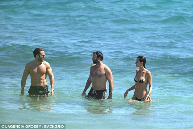 Having a ball:Having been engaged for almost ten years, the pair looked happier than ever to be in each other's company, as they joked and laughed from the comfort of the water
