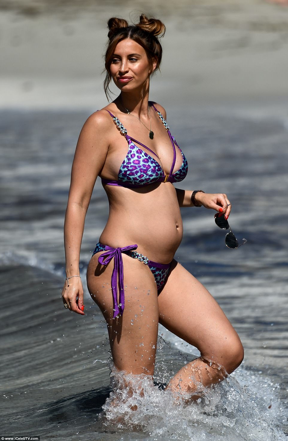 Beauty: Pregnant Ferne McCann, 26, looked sensational as she hit the beach in a skimpy leopard print bikini on her recent getaway to Mallorca
