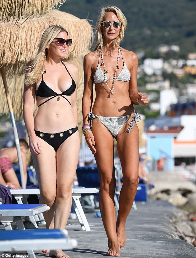 Bikini babes: Lady Victoria Hervey and Hofit Golan showed off their slim figures in Ischia on Sunday as they attend the island's film festival