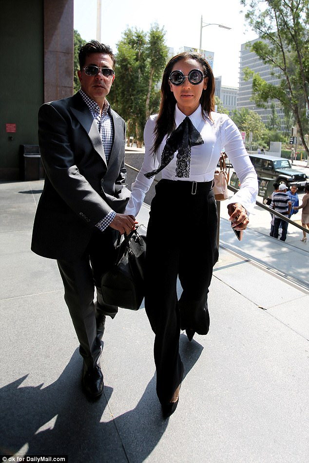 'Extravagant lifestyle': It's been claimed Mel B has just £961 left in one of her company accounts, she is seen arriving at Los Angeles Superior Court with her lawyer for a hearing in her divorce battle with Stephen Belafonte earlier this week