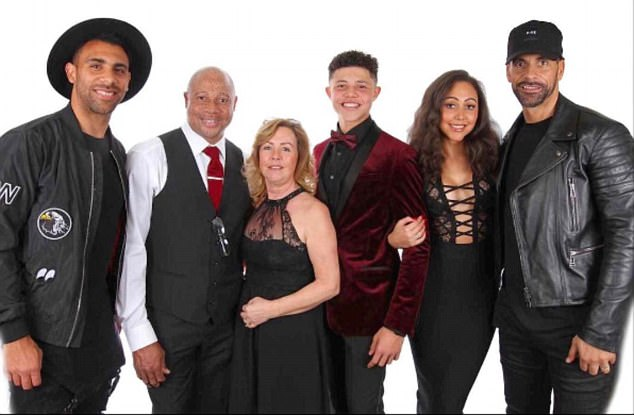 Another photo showed Sian (second from right) posing with her half-brothers (far left and right), brother, father and mother (centre) with the caption 'my forever squad'
