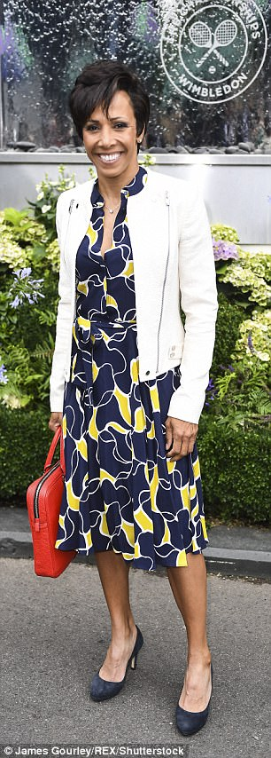 Looking sharp: Another lady out to cheer on Venus Williams and Garbine Muguruza was Dame Kelly Holmes, who looked sensational in a classic navy, white and yellow sun dress with a ruffled skirt