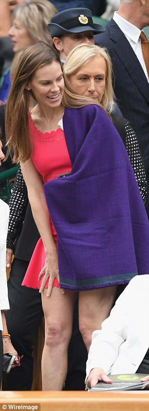 Wrapping up: Hilary settled into her seats and kept warm with a typically-Wimbledon purple wrap