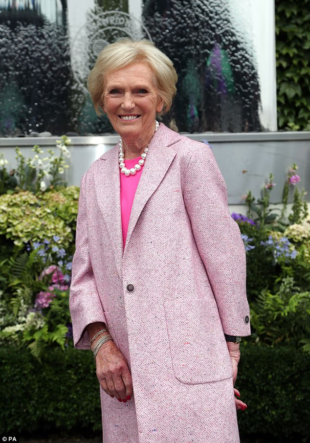 Lovely in light pink: Joining the Hollywood star was Mary Berry covered up with a light pink trench coat and, much like fellow guest Hilary, kept her make-up clean