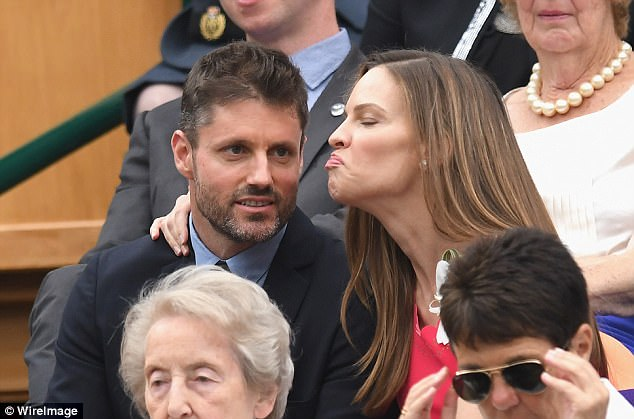 Kiss, kiss: And one lady who was winning off-court was Hollywood stunner Hilary Swank who was more interested in kissing her hunky boyfriend Philip Schneider as they delightedly watched on among the great and good of the showbiz world