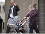 Accused: Paul Roberts and Deborah Briton, centre, leave court with her daughter Charlene