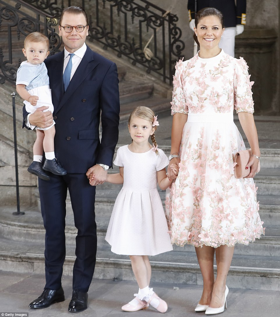 Picture-perfect family: Princess Victoria attended the service with her husband  and children