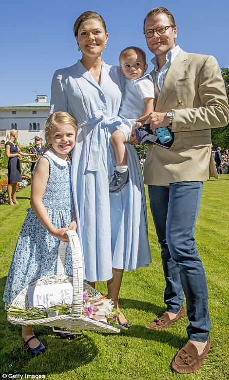 Fun in the sun: Princess Victoria's husband and the children's father, Prince Daniel, who wore a pale blue shirt under a beige double-breasted summer blazer, smiled and laughed as his family enjoyed the Swedish sunshine