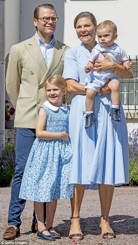 Although Prince Oscar's somewhat grumpy face may not have been in keeping with his mother and sister's dazzling smiles, his sky-blue waistcoat and white shirt complemented the ladies' outfits