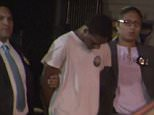 Justin Williams, 17, confessed to being one of the four men who allegedly pounced on a 50-year-old woman after she left a church in Queens, New York and forced her to perform oral sex at gunpoint. He is seen above being led away by police officers on Friday