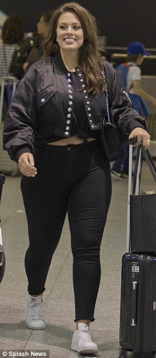 Black on black: The beauty was dressed entirely in black, with the exception of her white sneakers