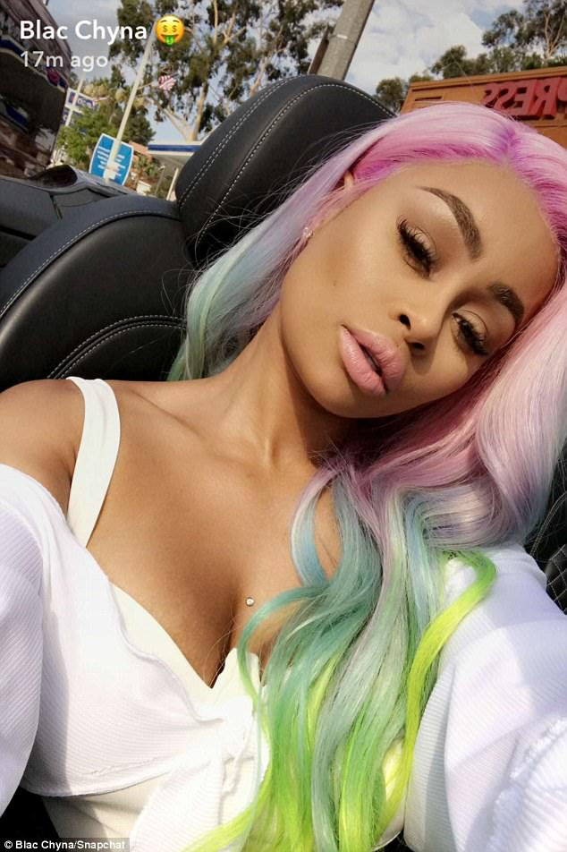 Striking: Blac loves to experiment with different wigs in a bid to mix up her look and recently chose this fun rainbow number