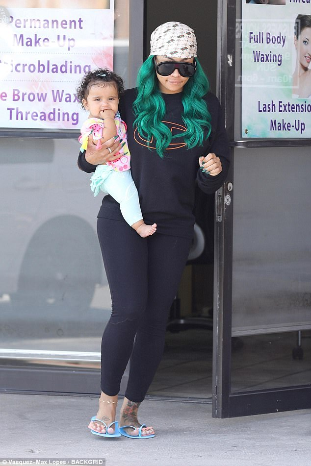 Colourful: She even wore a bright green version for a trip to the nail salon with her daughter Dream last week