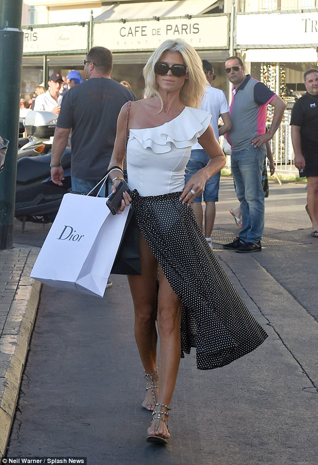 It's Dior darling! Victoria Silvstedt 42, flaunted her endless bronze legs in the soaring split of her polka dot sarong when she hit the shops in St Tropez, south of France on Friday