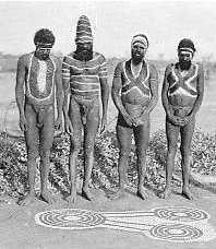 Men painted for ceremony