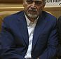 In this picture taken on Monday, July 3, 2017, Hossein Fereidoun, brother and top aide of moderate Iranian President Hassan Rouhani sits in a conference in Tehran, Iran. The semi-official Tasnim news agency reported on Sunday, July 16, that Hossein Fereidoun has been detained over financial matters. (AP Photo/Vahid Salemi)